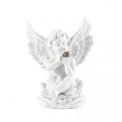 Anjel sediaci sguľou vruke